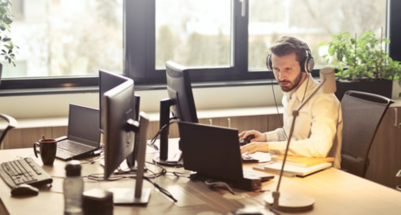 Customer Support Agent at Desk - Call For A Free Quote
