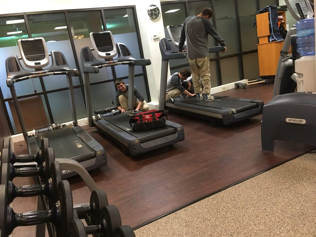 LGM Movers Disassembling Workout Equipment